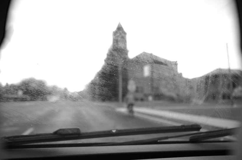 blurry view out a car window in the rain
